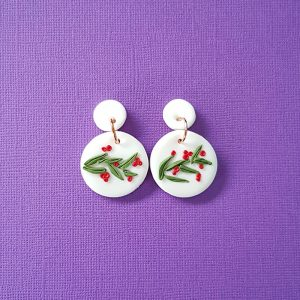 Australian Christmas Earrings featuring a christmas bush floral design on a white background handmade from polymer clay