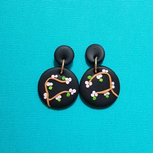 Cherry Blossom earrings handmade from polymer clay pink blossom on black background